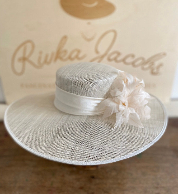 White wedding hat with silk band and feather flowers