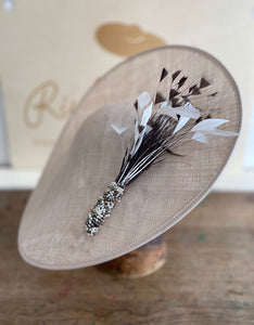 Large coffee coloured saucer hat, spray of small feathers incased in beads