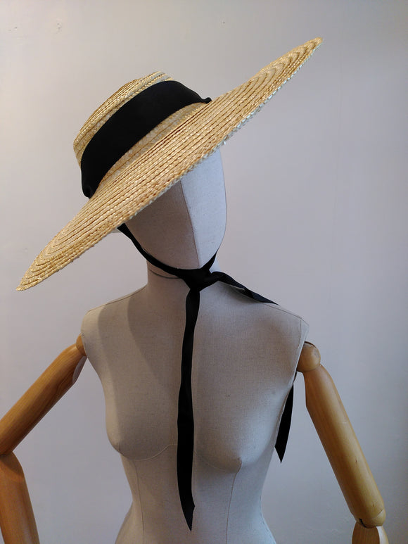 Straw sun hat with black ribbon