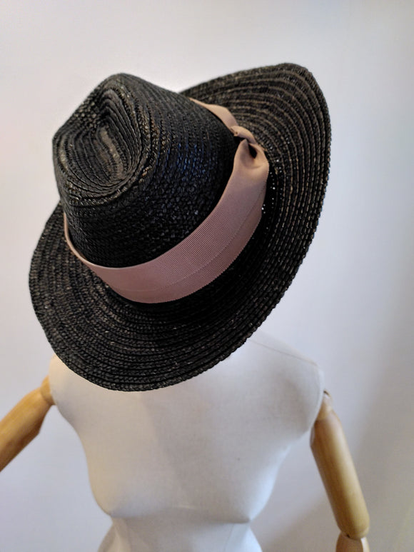 black triby hat with soft pink band.