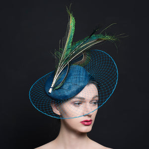 Sea Blue button beret, with blue veil stretch brim and peacock feathers.