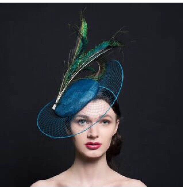 Peacock blue fascinator hat, with veil brim