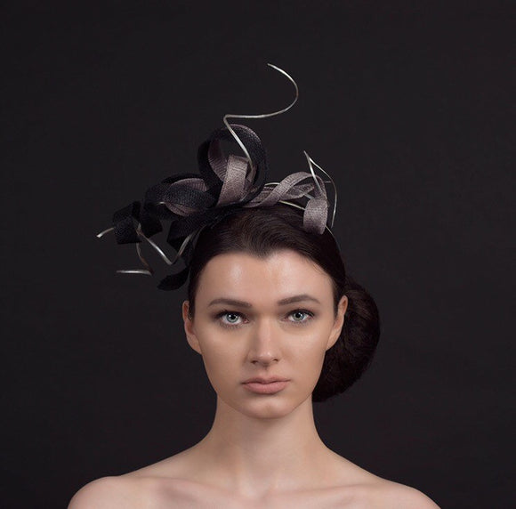 black and silver twisted fascinator with silver twirls, perfect for weddings and occasions