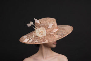 blush pink, wide brimmed hat, with silk flowers and spray of feathers