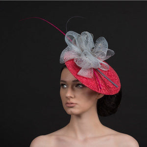 Pink fascinator with oversized grey bow with pink and grey quills