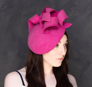 Shocking pink felt sculptural hatinator/fascinator.