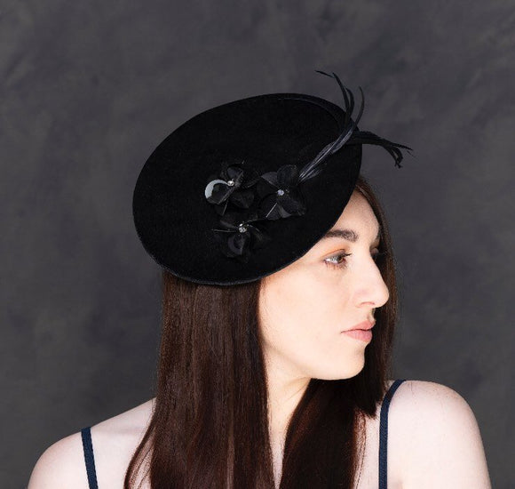 black velvet saucer hat, with feathers and flowers