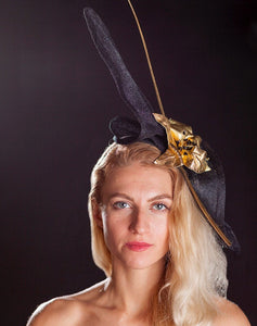Black fascinator, with gold flowers.