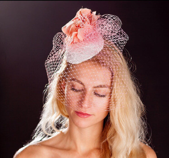 Pink bird cage veil, white lace base and pink rose fascinator. rivka jacobs millinery devon uk