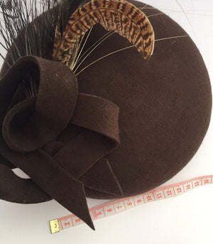 Brown felt beret with spray of feathers