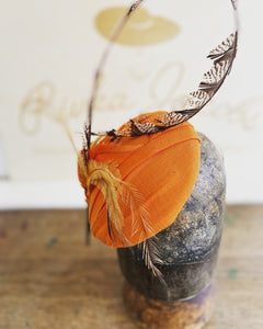 Orange and feather hatinator- for weddings