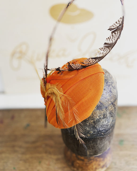 Orange and feather hatinator- for weddings, rivka jacobs- millinery