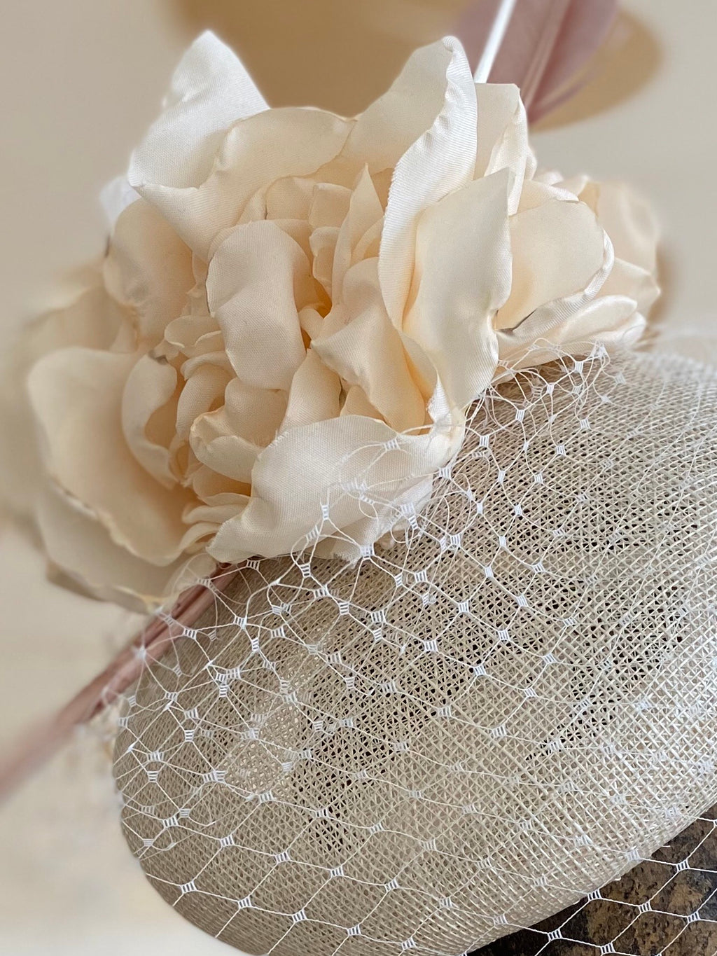 Cream rose and veiling hatinator- for weddings