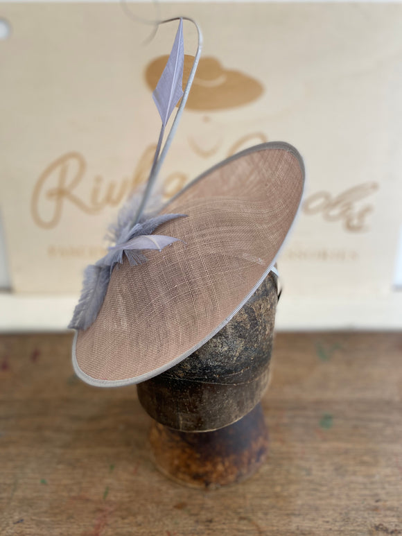 Grey saucer hat with grey feathers, quills and grey arrow feathers
