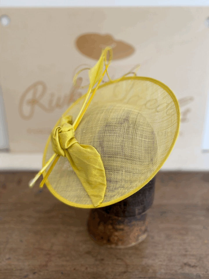 Sunny yellow saucer hat with silk bow and feathers