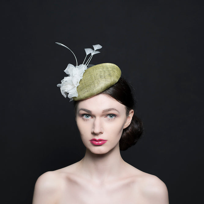 light green button beret hat/fascinator with a silk white rose and a spray of white feathers