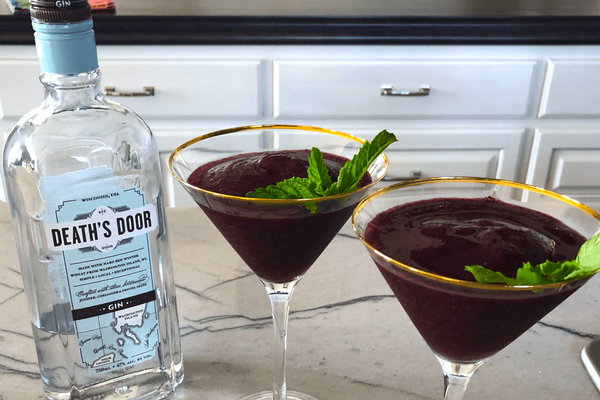 Finished Frozen Blueberry Lime Cocktails with mint garnish, by Kaftan Life