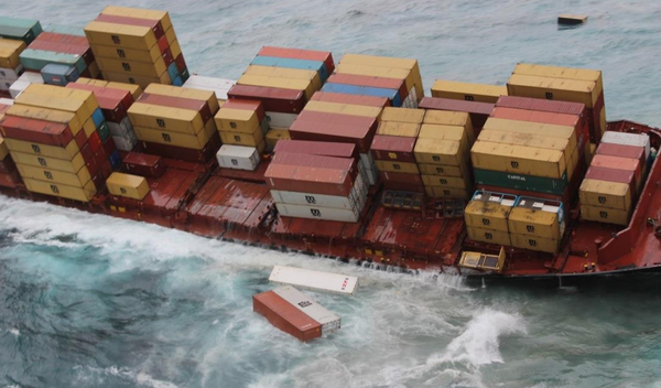 Containers falling off of ship at sea