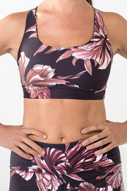 black and burgundy large floral printed strappy back sports bra