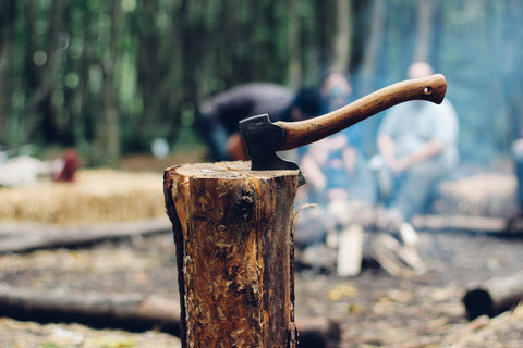 Chopping firewood with axe