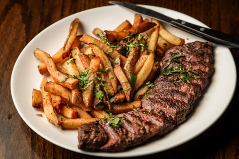Dinner plate with steak and fries