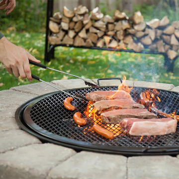 Meat cooking over BBQ grill grate
