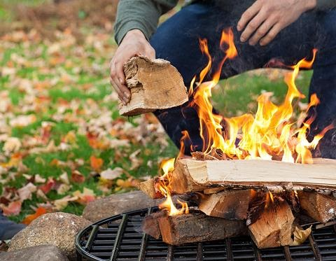Starting a fire on fire pit grate