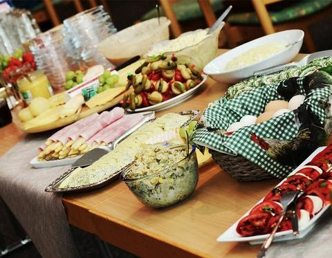 Table filled with potluck food
