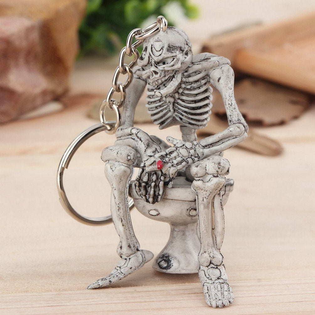 Skeleton On Toilet Key Chain