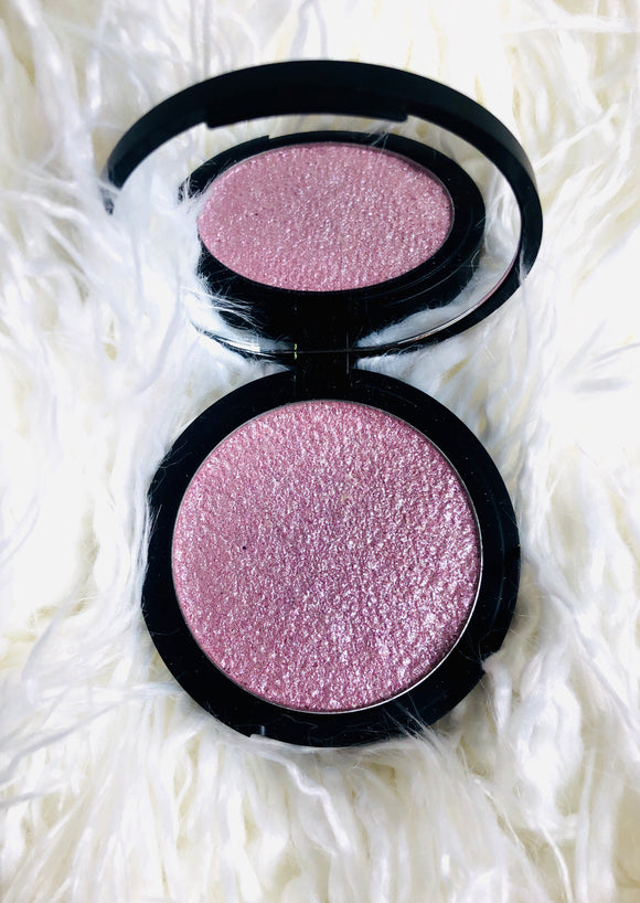 pink highlighter in black mirrored compact