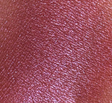 Purple pink eyeshadow swatched on arm shimmer pink shimmer purple shimmer