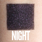Black eyeshadow with purple shimmer editorial makeup