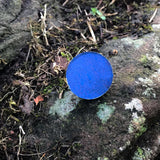 Image of Talisman navy blue by the collective cosmetics on a rock
