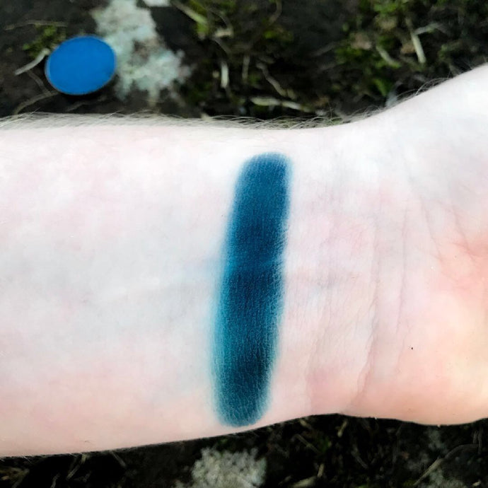 Rich deep true matte navy blue swatched on pale arm stunning pigmentation