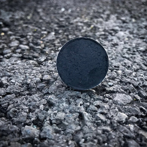 Pigmented black shadow on a black road in Liverpool housed in a 26mm magnetic shadow eyeshadow pan