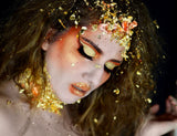 Beautanica wearing golden makeup. Dramatic golden eye makeup. Editorial makeup