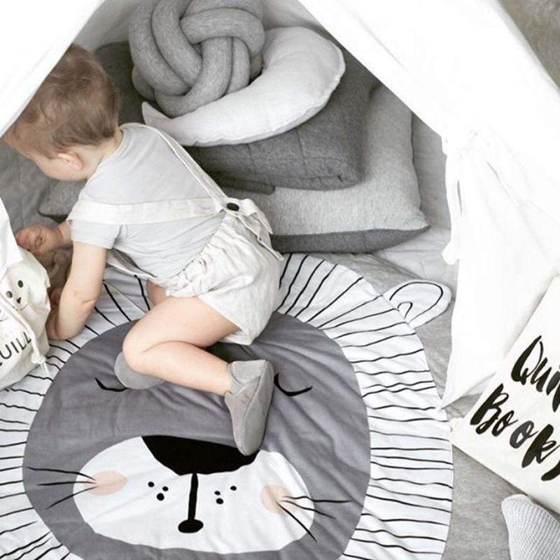 Child playing on rug Lion Cub drawing printed soft woven activity and play mat rug for baby and children room gray and white