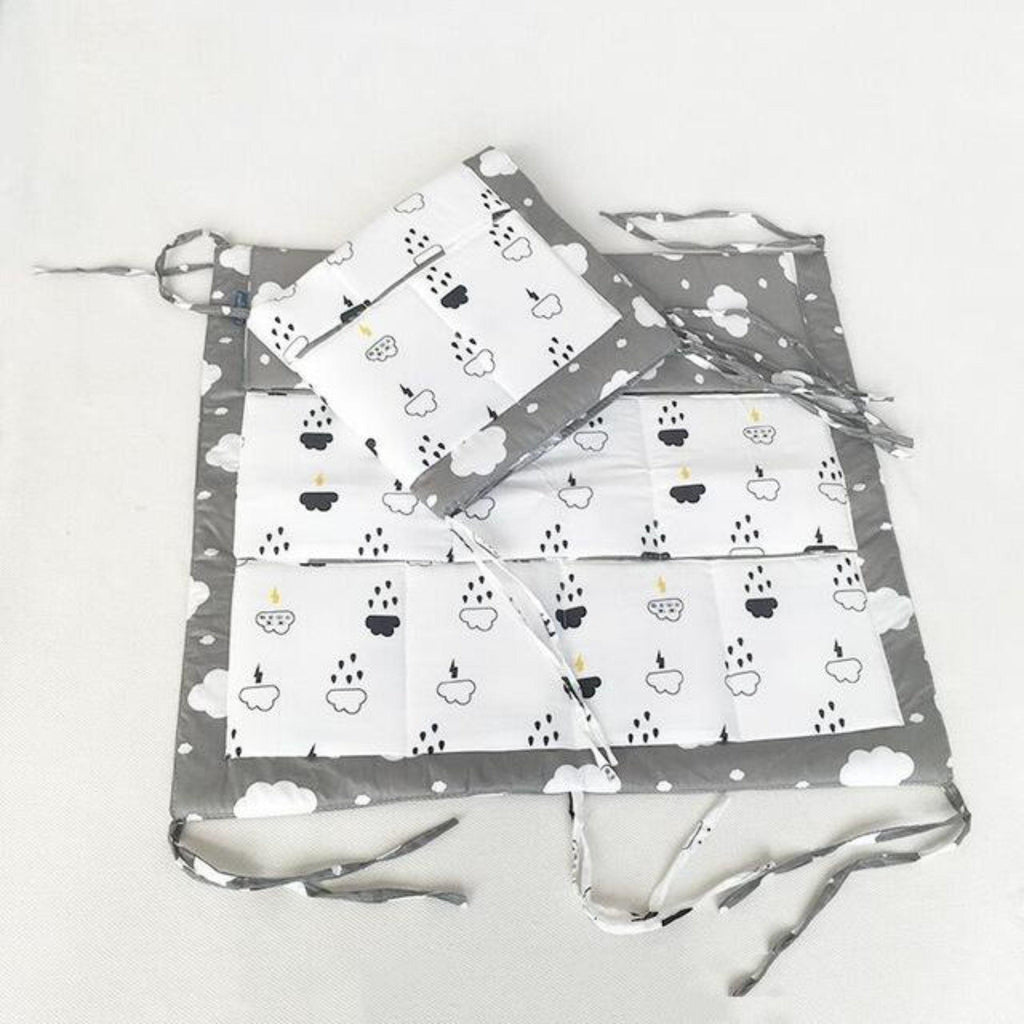 Gray rain clouds printed cotton crib organizer with self ties and pockets for storage of toys diapers