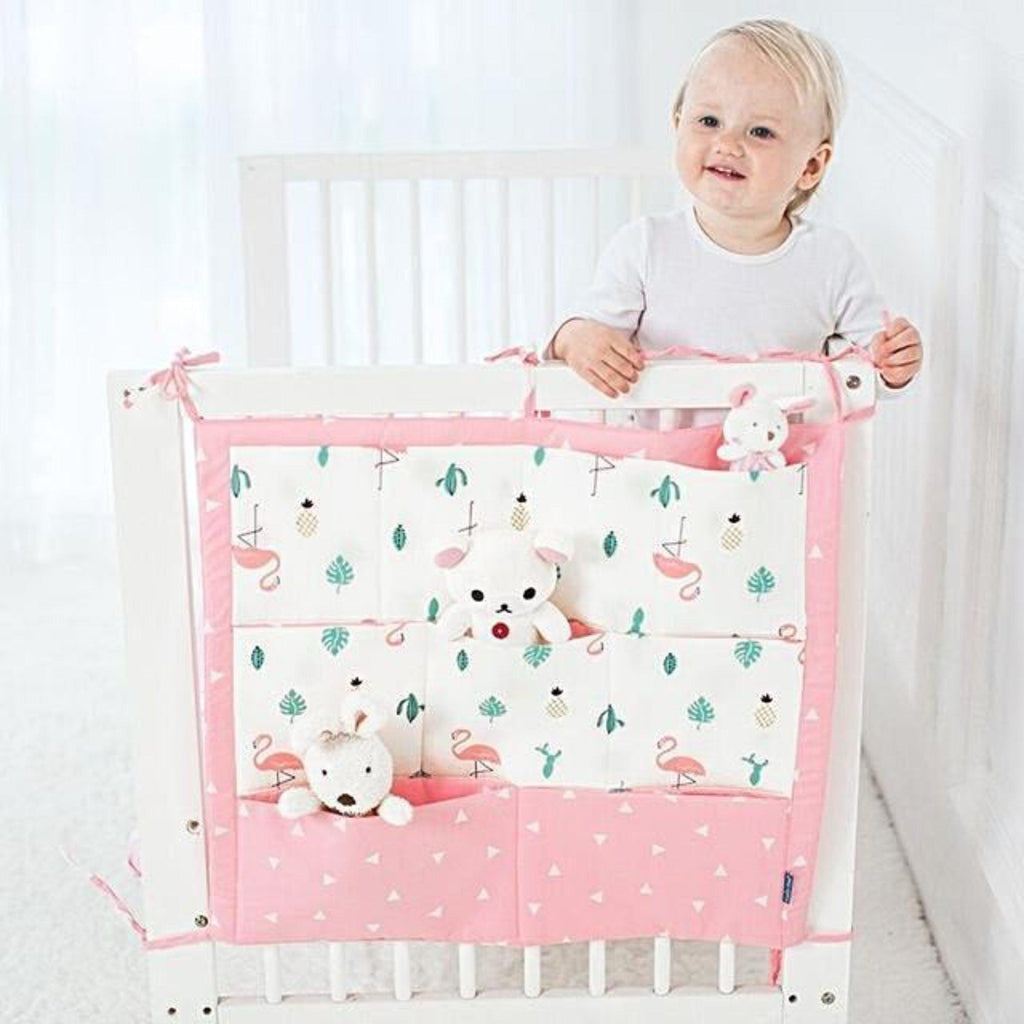 Flamingo and pineapples crib organizer with self ties and pockets for storage of toys diapers