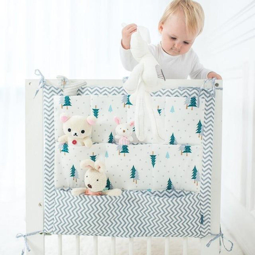 Green woodland pine trees and chevron cotton crib organizer with self ties and pockets for storage of diapers and toys