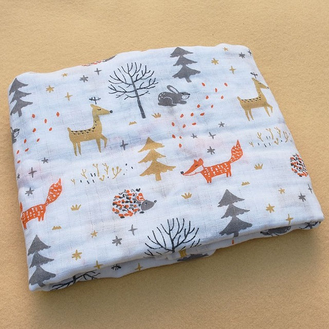 Woodland animals fox orange and white print cotton swaddle blanket