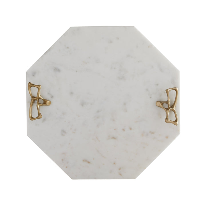 The corresponding serving tray to our Wakefield Ice Bucket (6825), this piece lets you serve your spread in style. The hexagonal shape of the white marble tray creates sharp, clean lines that draw the eye and add depth when resting on a tabletop. The antique brass handles are both sculptural and functional. A sophisticated way to serve hor d'oeuvres at your next soirée. Food safe. Marble may vary.  H: 1.5in Dia: 14in
