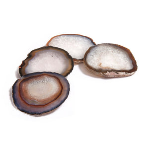 "SET OF 4 Our classic design makes an ideal host or hostess gift. This product, named after the Portuguese word for ""stone"", is authentically created from pure, semi-precious agate. Each coaster is hand- polished in Brazil and protected by rubber feet on the underside.  Approximately 4.5""/11cm This is a natural product- size, color, and pattern may vary. Agate Hand wash with mild soap and damp soft cloth. Made in Brazil. Natural."