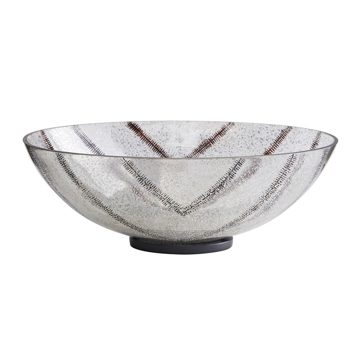 With all its shine and gloss, this centerpiece will catch the eye of many an admirer. Eighth-inch glass is given extra shine with a silver leaf antiqued finish and trails of etched leaf designs in a warm bronze tone. Rests on a natural iron disk base. For decorative use only. Finish may vary.  H: 5.5in W: 15in D: 10in
