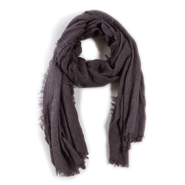"The Lightweight Frayed scarf is an airy, soft accessory. Perfect for any time of the year!  DETAILS:  76""x37"" Viscose/Acrylic blend"