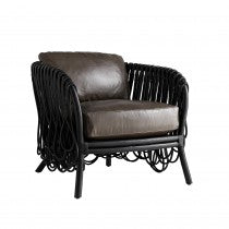 Thick squared cut strips of rattan are looped to create the intricate overlapping pattern that wraps the entire frame. Its organic aesthetic is modernized in a deep black finish, with graphite leather cushions that add a level of luxury.   Seat Interior W:26in Seat D:24in Seat Cushion (thickness):5in Overall Dimension W:34in Overall Dimension H:30in Overall Dimension D:32in Clearance: 12in