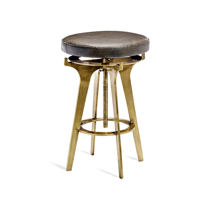 "Colton Adjustable Brass Stool - Duvall Atelier Putting the style in industrial-chic, The Colton adjustable stool boasts a rich leather seat topping an iron base in an antique brass finish.  DIMENSIONS:  25-32"" X 16"" DIAM"