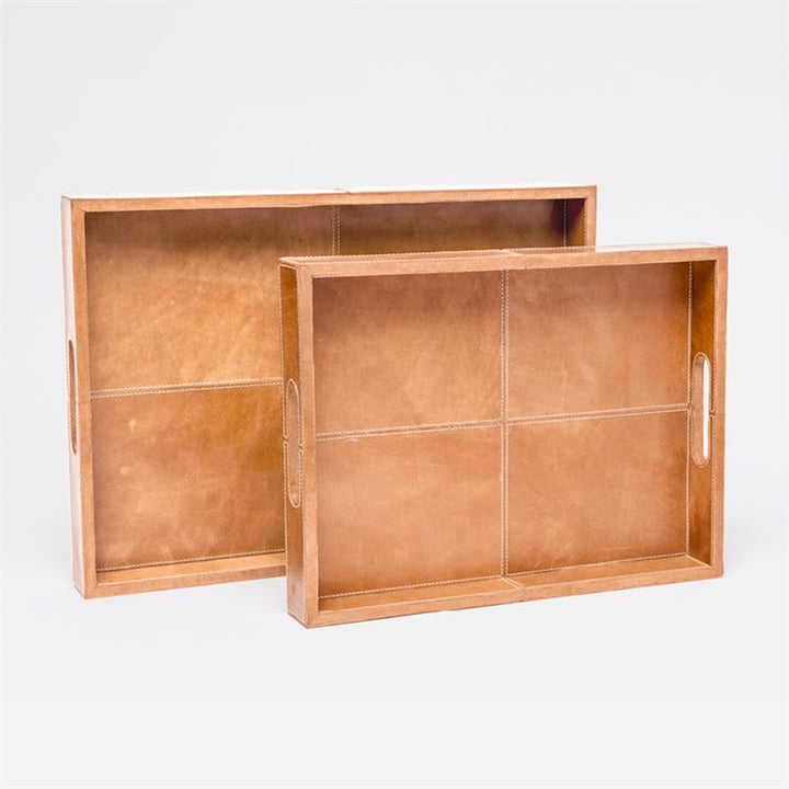 "This versatile tray brings out the natural grain of its exquisite material. Aged camel leather will lend an air of refinement to any surface.   Dimensions: 16''L x 12''W x 2''H, 20""L X 14""W X 2""H"