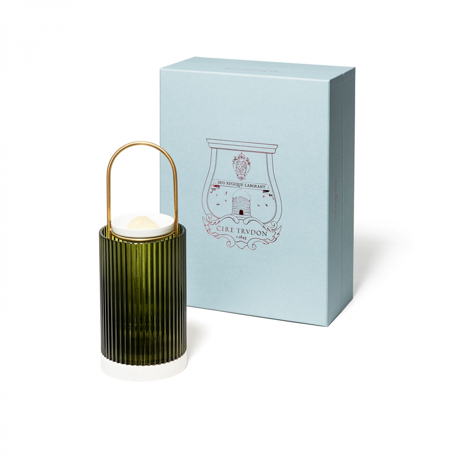 La Promeneuse is a decorative object designed to diffuse the Cire Trudon fragrances. After placing a cameo in the ceramic dish, light a night-light beneath it. The heated cameo will melt and spread its fragrance rapidly into the air.  La Promeneuse allows to easily change fragrances.  4 scented cameos (Abd El Kader, Ernesto, Odalisque et Solis Rex) and 4 night lights are included in La Promeneuse.