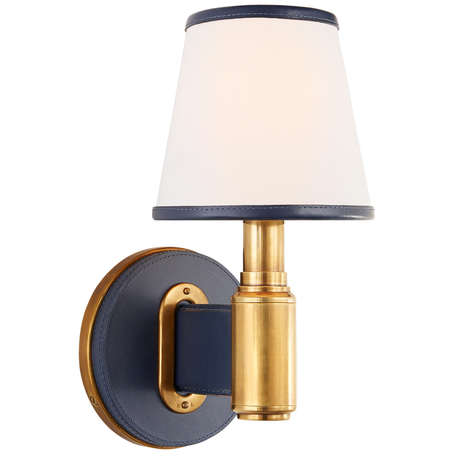 Finish: Natural Brass and Navy Leather with Leather Trimmed Linen Shades